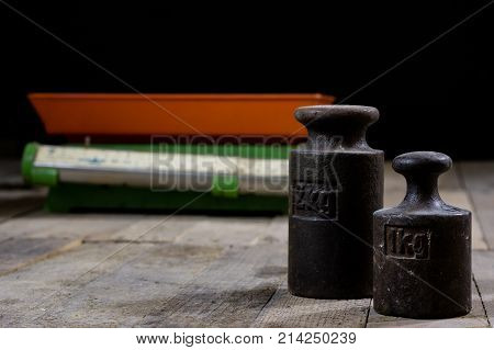 Old Weight And Weights On A Wooden Table. Old Used Kitchen Scale With Old Scale And Kilogram Weight