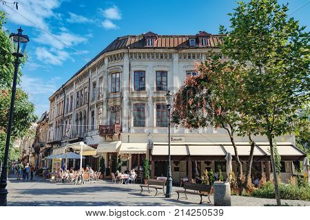 Bucharest, Romania - September 9, 2017: Street lined up with pubs and restaurants in the historical center of Bucharest - Old town. Italian Restaurant Il Peccato