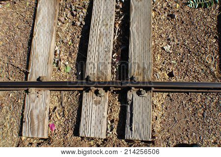 3 rail road ties with one rail small gauge weathered