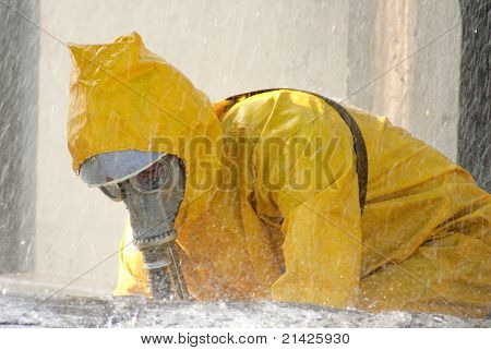 man in a yellow chemical protection suit running in the rain poster