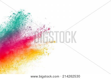 Abstract multicolored powder splatter on black backgroundFreeze motion of color powder splash. Color dust explosion on background.