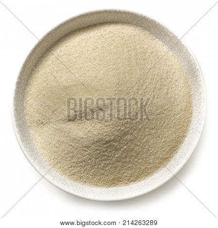 Semolina flour in bowl.  Top view, isolated on white.