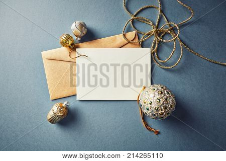 Christmas Card with Golden Christmas Decorations; flat lay arrangement