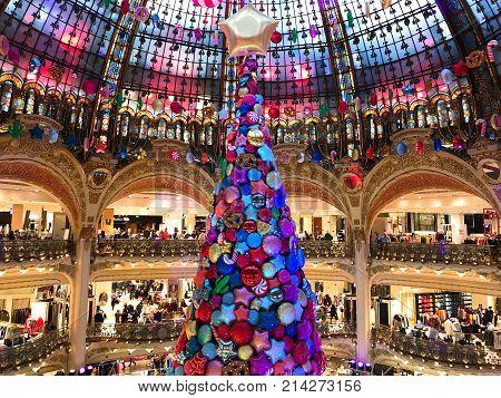 Paris France, 16 November 2017: Giant Christmas tree inside Galeries Lafayette Parisian department store