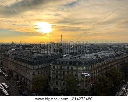 Paris France, 16 November 2017: aerial view on Galeries Lafayette Parisian department store and with the Eiffel Tower in background