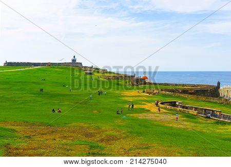 San Juan, Puerto Rico - May 08, 2016: The people resting near fort San Cristobal in San Juan, Puerto Rico on green grass