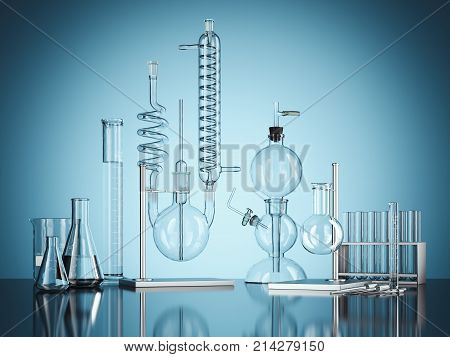 Glass chemistry lab equipment on blue background. Chemistry Lab concept.