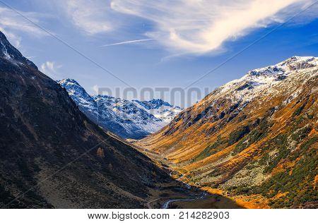 Landscape of the Swiss Alps and forest of national parc in Switzerland. Alps of Switzerland on autumn. Parc Naziunal Svizzer. Swiss canton of Graubunden.  Val Müstair Region