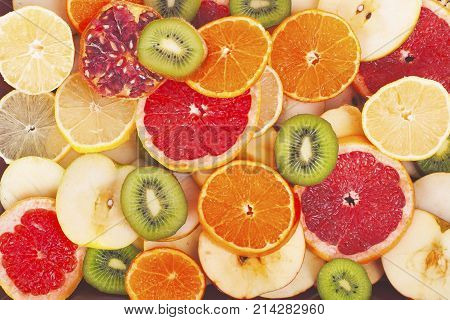 Fruit textures. Kiwi orange grapefruit lemon apple pear pomegranate mandarin fruits as background cover wallpaper. Colorful fresh fruits in rainbow colors. Beautiful delicious fruits wallpaper. Sweet.
