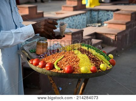 Senior man selling spices and vegetables at a fruit market in Jaipur Rajastan India.