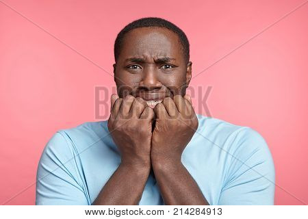 Nervous Dark Skinned Man Has Sorrorful Expression, Clenches Teeth, Tries Not To Cry, Finds Out About