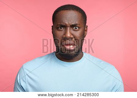 Discontent Young African American Male Curves Lips, Dislikes What He Sees, Displeased With Bad News,
