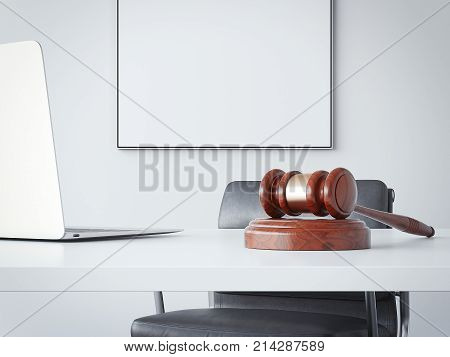 Office table with a wooden hammer of the judge. 3d rendering
