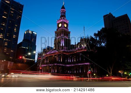 Light moving of bustling city center scene with old clock tower in Sydney