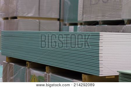 Plasterboard sheet many lie in the warehouse