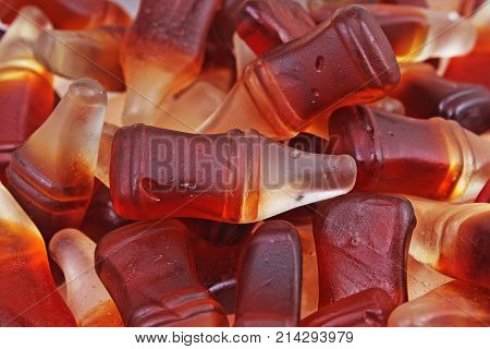 Cola gum candy. Gummy candy cola flavored sweet snack. Cola bottle shaped sweets. Sugar.