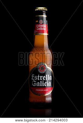 London, Uk - November 17, 2017: Bottle Of Estrella Galicia Pale Lager Draft Beer On Black. Estrella