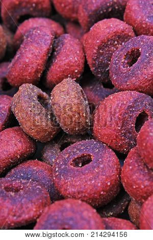 Dog pet food texture. Dog Meat food background pattern texture. Red round animal food. Meat.