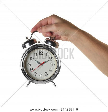 Objects Hands action - Hand holds vintage retro alarm clock isolated white background.