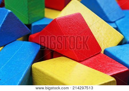 Wooden toy blocks background. Red, Blue, Yellow Green Wooden toy blocks on white background. Wood block texture pattern. Colorful photo.