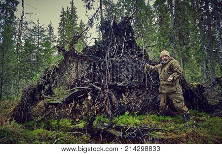Photographer Works In The Forest,