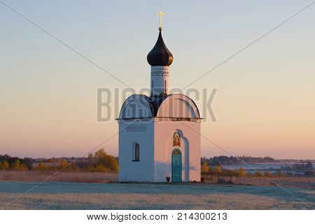 Chapel of the Sovereign Icon of the Mother of God in the morning October frost in the vicinity of Izborsk. Pskov region, Russia poster