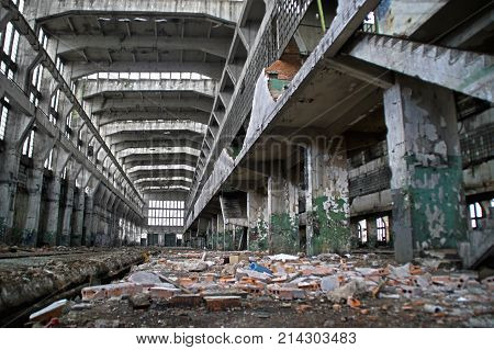 Old destroyed factory hall. Huge industrial space in a forgotten place.