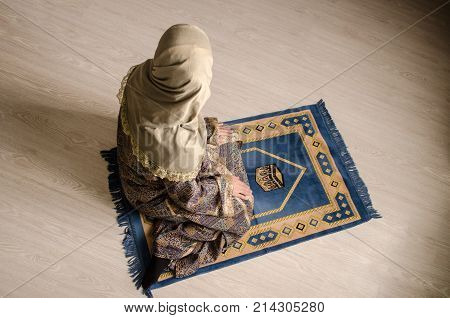 Muslim Woman Praying For Allah Muslim God At Room Near Window. Hands Of Muslim Woman On The Carpet P