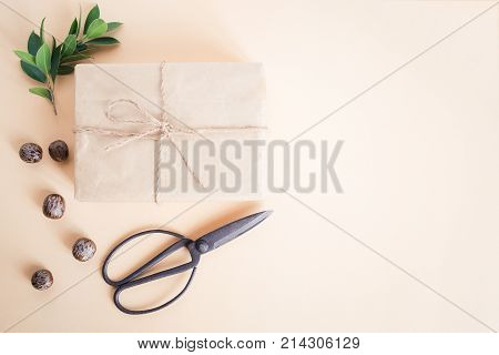 Brown gift box on yellow background,handmade gift box and scissors christmas concept top view