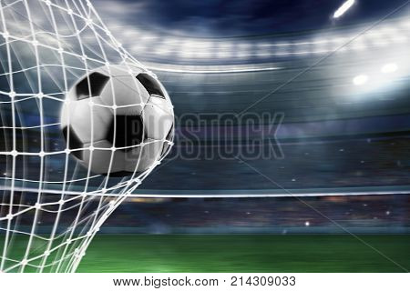Ball scores a goal on the net in a football match