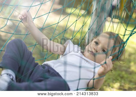 baby relaxing in the hammock on the garden