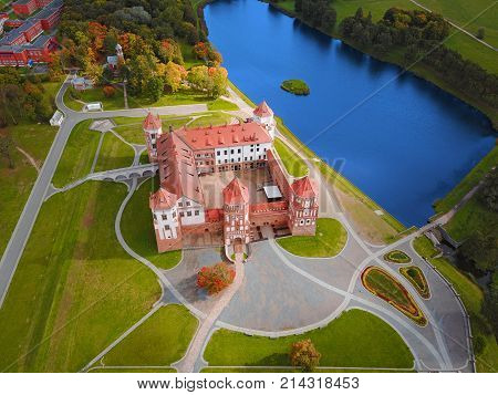 Mir Castle Complex Belarus Europe. Aerial view of famous belarusian medieval castle. Historic building in autumn. Symbol of belorussian architecture. Cityscape of Mir. Birds eye panorama
