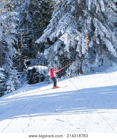 Skiing ski skier - skier man on the in mountains at wonderful sunny day