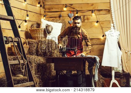 Tailor Man Sews Clothes