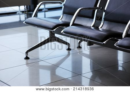 departure lounge at the airport waiting chairs