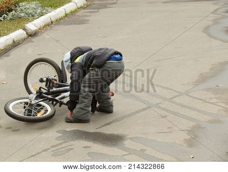The Boy Fell Off His Bike And Picks It Up Yourself