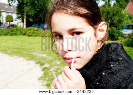 Girl Drinking Through Straw
