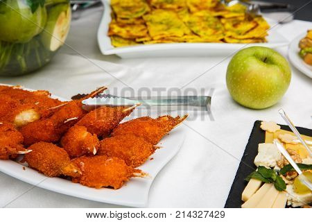 Hot and Spicy Buffalo Chicken Wingson on the table. Hot Meat Dishes - Fried Chicken Wings in a white plate. Snacks. buffet table. restaurant feed. New Year Christmas