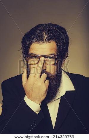 Bearded Man Rearranges Glasses