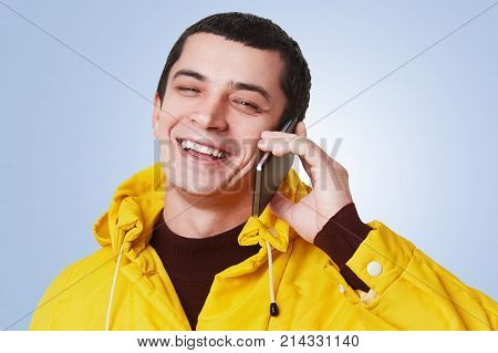 Young Happy Handsome Man Has Phone Conversation, Talks With Best Friend, Discuss Something With Glad