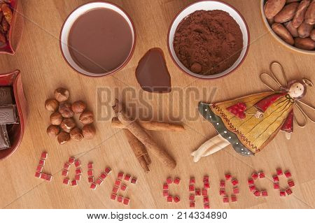 It is image of hot chocolate drink with ingredients on it