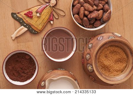 It is image of hot cocoa drink and ingredients on it