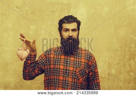 Happy Bearded Man With Beard Holds Rosy Textile Heart