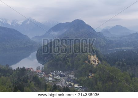 Beautiful view of the Hohenschwangau Castle and the Alpsee lake from the Neuschwanstein castle located near the city of Füssen, Munich