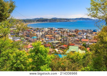 Spectacular aerial view of Kamakura Sagami Bay from second level in Hase-dera temple or Hase-kannon in Kamakura, Japan. Beautiful sunny day with blue sky. Kamakura skyline.