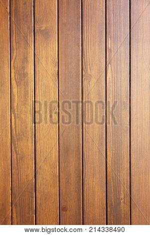 wooden boards painted in brown color, vertical image