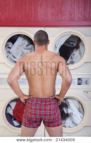 Muscular Man In Laundromat
