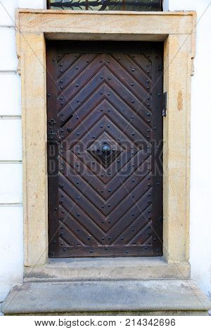 old wooden door with metal rivets, outdoors