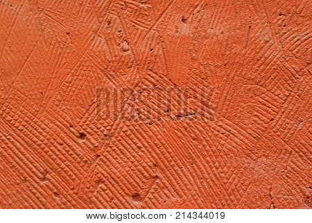 background texture: orange deliberately coarse plastered wall of a building close-up