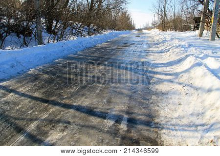 Rural Frozen Slippery Asphalt Road On Winter